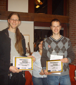 Matthijs and Christiaan showing their award